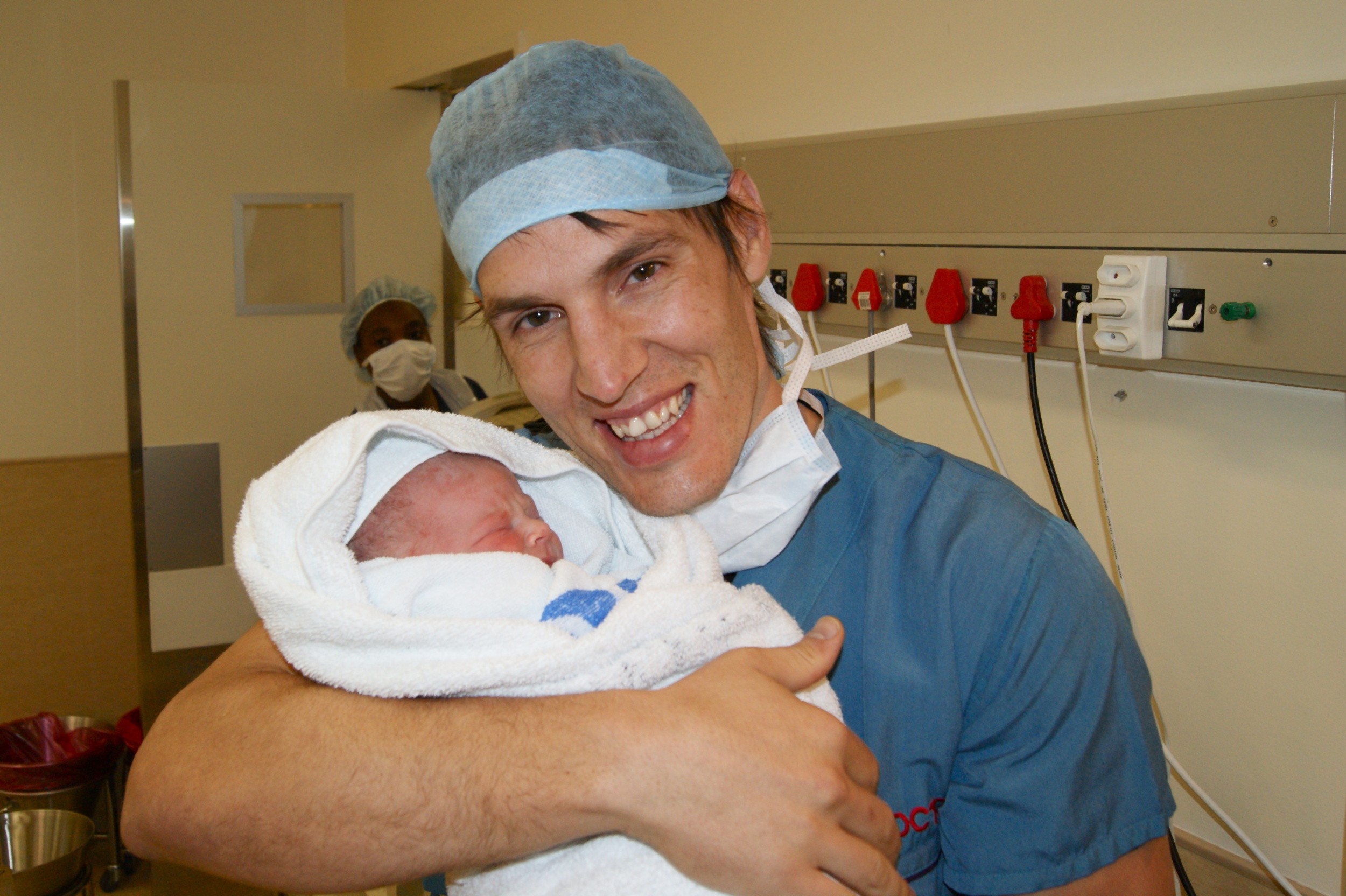 New dad holding newborn baby