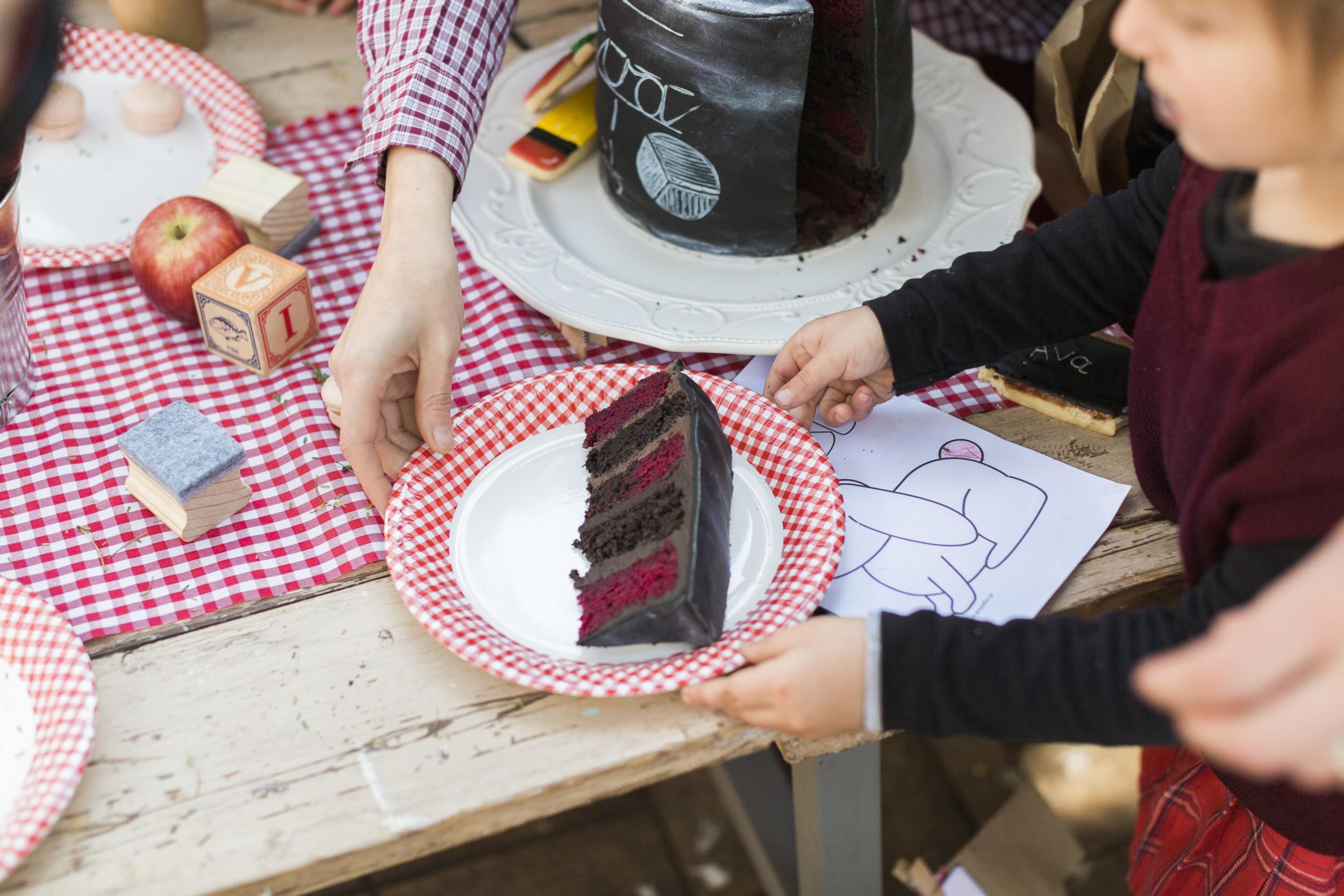 Red and black layered birthday cake